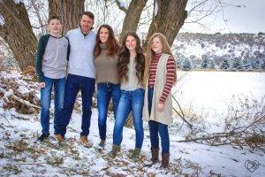 winter family portraits engagement surprise by Christie Bryant